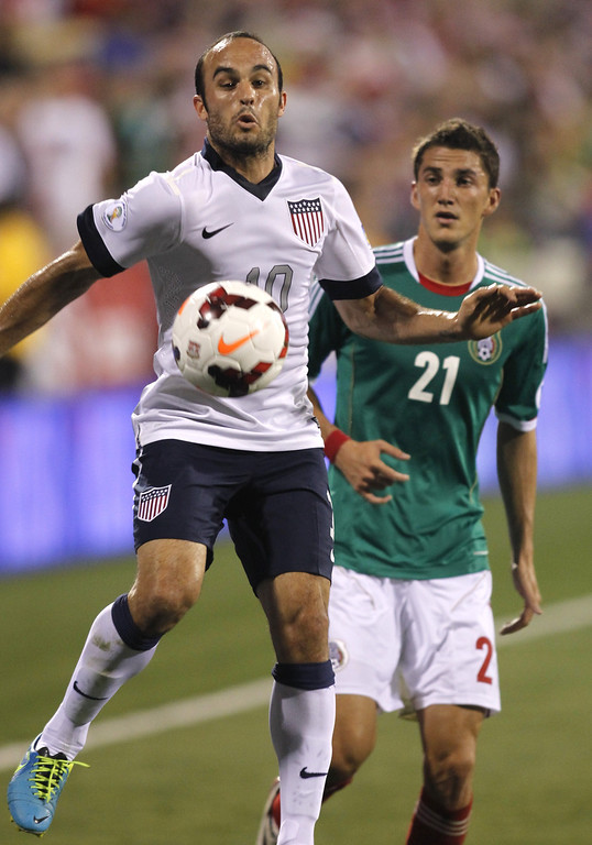 . Landon Donovan (L) of USA works for the ball in front of Hiram Mier of Mexico during the first half of their Brazil 2014 FIFA World Cup qualifier at Columbus Crew Stadium in Columbus, Ohio, September 10, 2013.  AFP PHOTO / PAUL VERNONPaul VERNON/AFP/Getty Images