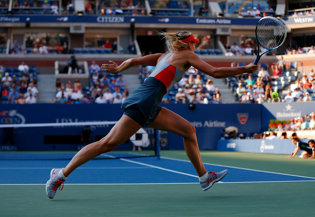 . Maria Sharapova, of Russia, chases down a shot against Alexandra Dulgheru, of Romania, during the second round of the 2014 U.S. Open tennis tournament, Wednesday, Aug. 27, 2014, in New York. (AP Photo/Matt Rourke)