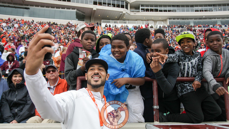 Former Virginia Tech QB and current Buffalo Bill Logan Thomas takes a selfie with fans in the first row. (Mark Umansky/TheKeyPlay.com)
