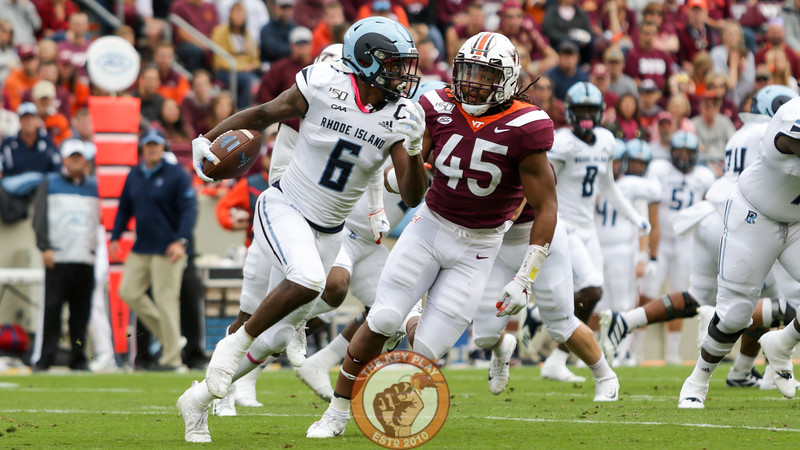 Defensive lineman TyJuan Garbutt chases Rhode Island WR Aaron Parker in the first quarter. (Mark Umansky/TheKeyPlay.com)