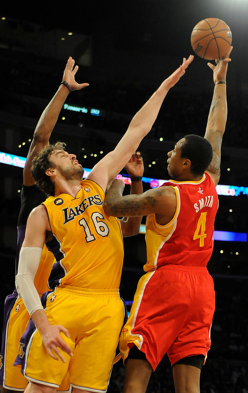 . Lakers#16 Pau Gasol goes up to contest a shot by Rockets#4 Greg Smith in the first quarter. The Lakers faced the Houston Rockets in the final home game of the year at Staples Center in Los Angeles, CA 4/17/2013(John McCoy/Staff Photographer
