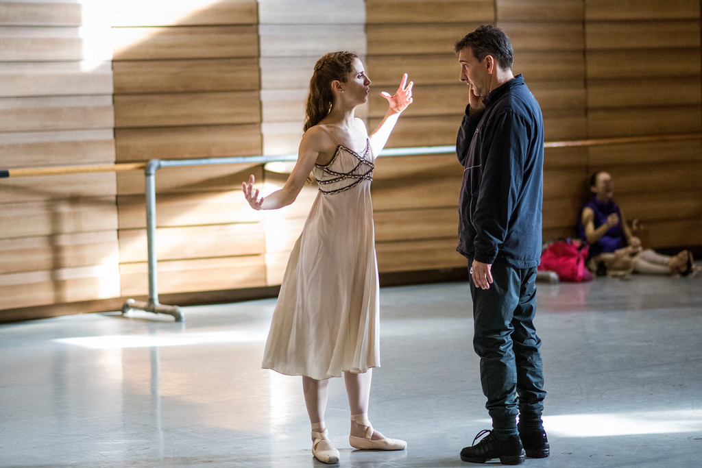 . In this Tuesday, Sept. 12, 2017 photo, Director Julio Bocca instructs principal ballet dancer Maria Noel Riccetto during rehearsal for Romeo and Juliet in Montevideo, Uruguay. Bocca recently announced that he would be stepping down as director of Uruguay�s National ballet of the Sodre but that he will continue to live in Uruguay and will focus fully on teaching the company and completing his dream of turning it into one of the best in the world. (AP Photo/Matilde Campodonico)