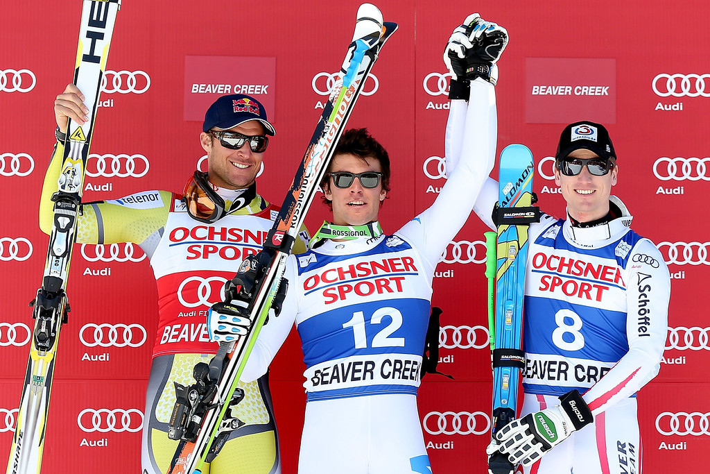 . Aksel Lund Swindal #19 of Norway, Matteo Marsaglia #12 of Italy and Hannes Reichelt #8 of Austria celebrate on the winner\'s podium during the men\'s Super G on the Birds of Prey at the Audi FIS World Cup on December 1, 2012 in Beaver Creek, Colorado.  (Photo by Matthew Stockman/Getty Images)