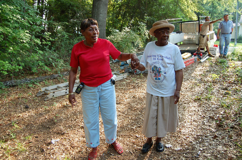 2008 07-19 Atlanta, GA - Mrs. Bailey (right) led around her yard to observe renovation of her house.