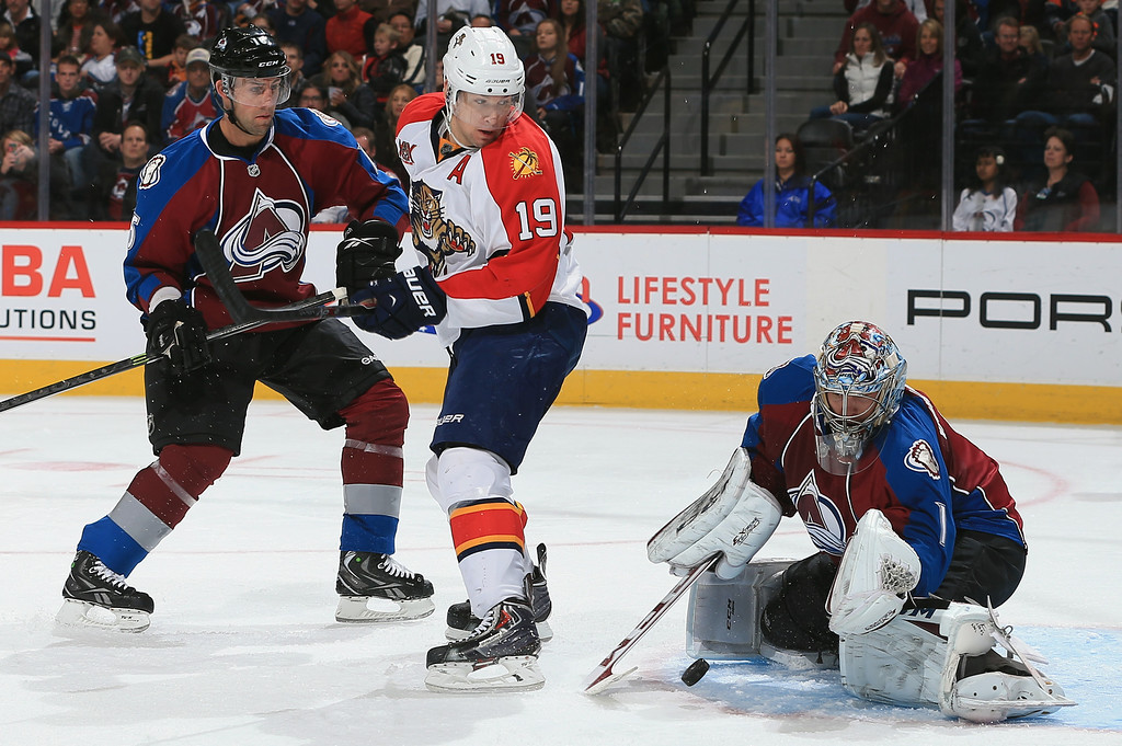 . DENVER, CO - NOVEMBER 16:  Goalie Semyon Varlamov #1 of the Colorado Avalanche makes a save as Cory Sarich #16 of the Colorado Avalanche and Scottie Upshall #19 of the Florida Panthers follow the action at Pepsi Center on November 16, 2013 in Denver, Colorado.  (Photo by Doug Pensinger/Getty Images)