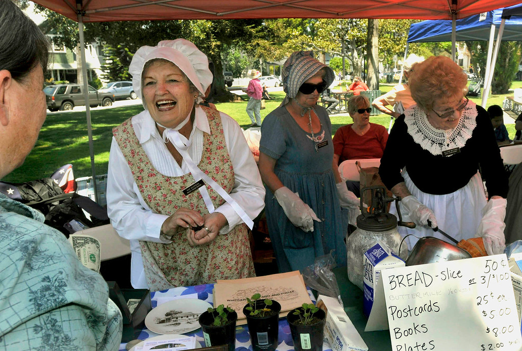 . Pat Kuypers (white bonnet) and other Bailey House Docents work the Bailey house booth.  The 119th anniversary of the founding of Whittier was celebrated during Founders Day at Central Park in Uptown Whittier, Saturday, May 11, 2013.  (Mike Mullen)