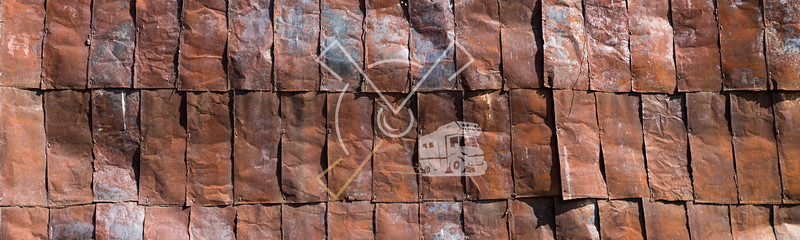 Old rusty pieces of metal from the Soviet Unian time Uranium mine and factories of Ming Kush are recycled for fencing