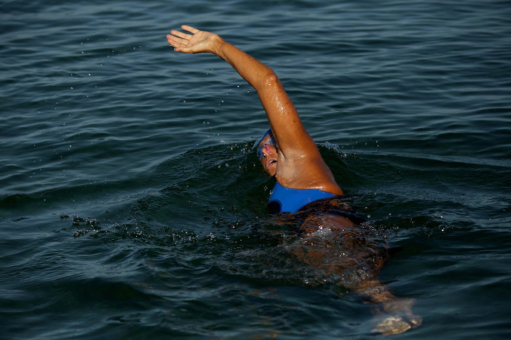 . U.S. swimmer Diana Nyad, 64, begins her swim to Florida from the waters off Havana, Cuba, Saturday, Aug. 31, 2013. Endurance athlete Nyad launched another bid Saturday to set an open-water record by swimming from Havana to the Florida Keys without a protective shark cage.   (AP Photo/Ramon Espinosa)