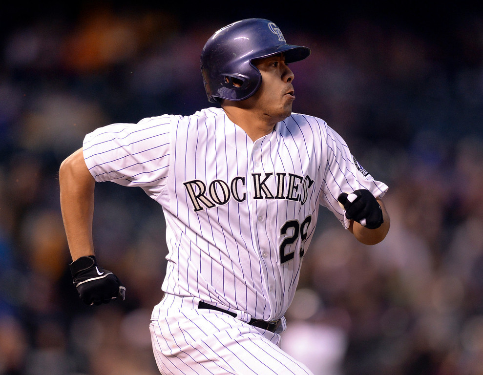 . DENVER, CO - MAY 15: Colorado batter Jorge De La Rosa raced to first base in the fifth inning. The Colorado Rockies hosted the San Diego Padres at Coors Field  Friday night, May 16, 2014. (Photo by Karl Gehring/The Denver Post)