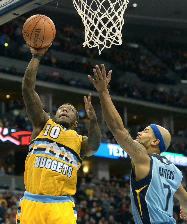 . DENVER, CO. - JANUARY 03:  Nuggets\' guard Nate Robinson (10) worked inside Memphis defender Jerryd Bayless (7) in the first half. The Denver Nuggets hosted the Memphis Grizzlies at the Pepsi Center Friday night, January 3, 2014. Photo By Karl Gehring/The Denver Post