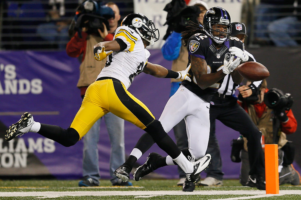 Description of . Wide receiver Torrey Smith #82 of the Baltimore Ravens drops a fourth quarter pass while being defended by defensive back Cortez Allen #28 of the Pittsburgh Steelers at M&T Bank Stadium on December 2, 2012 in Baltimore, Maryland.  (Photo by Rob Carr/Getty Images)