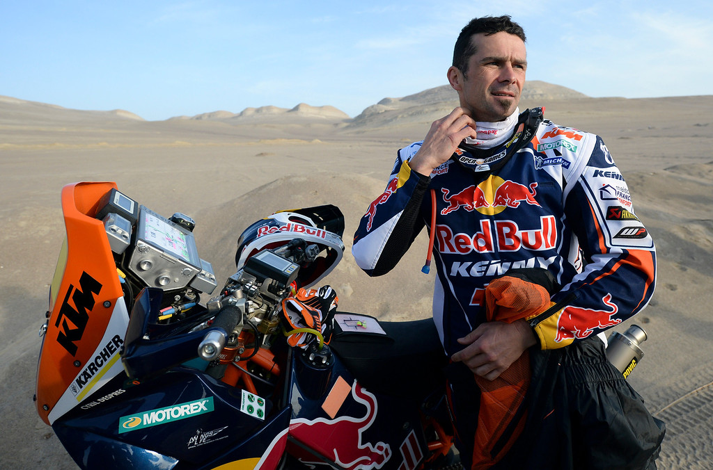 . KTM rider Cyril Despres of France gets ready before the start of the 2nd stage of the 2013 Dakar Rally in Pisco, Peru,  Sunday, Jan. 6, 2013. The race finishes in Santiago, Chile, on Jan. 20. (AP Photo/Franck Fife, Pool)