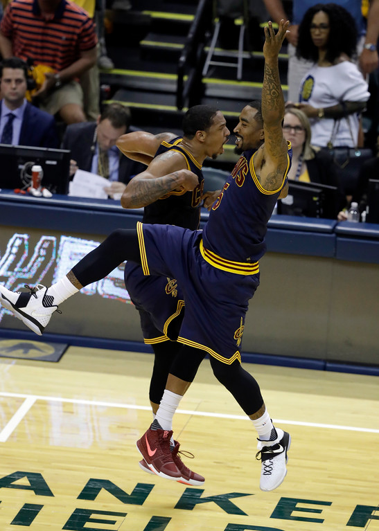 . Cleveland Cavaliers\' Channing Frye, left, and JR Smith celebrate during the second half in Game 3 of a first-round NBA basketball playoff series against the Indiana Pacers, Thursday, April 20, 2017, in Indianapolis. Cleveland defeated Indiana 119-114. (AP Photo/Darron Cummings)