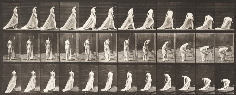 Semi-nude woman walking, turning and stopping to lift train (Animal Locomotion, 1887, plate 56)