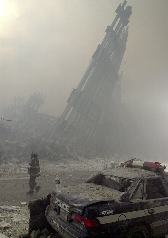 . Destroyed mullions, the vertical struts which once faced the soaring outer walls of the World Trade Center towers, are the only thing left standing behind a lone fireman, after a terrorist attack on the twin towers of lower Manhattan Tuesday, Sept. 11, 2001. (AP Photo/Mark Lennihan)
