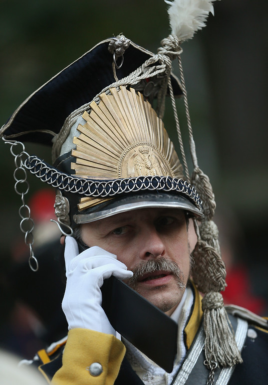 . An actor in the role of a soldier in the 7th Polish Lancer Regiment talks on a mobile phone upon his arrival for the opening ceremony to commemorate the 200th anniversary of The Battle of Nations on October 16, 2013 in Leipzig, Germany.  (Photo by Sean Gallup/Getty Images)