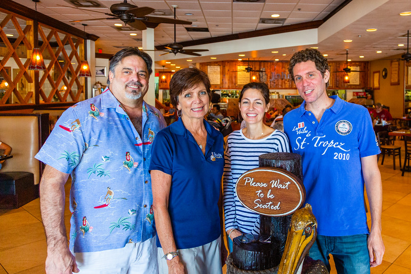 (From left:) Siblings Keith Giragos and Wendy Yarbrough (former owners) and  Doris and Laurent Di Meglio, the new owners of John G's in Manalapan on Wedneday, October 9, 2019.  [JOSEPH FORZANO/palmbeachpost.com]