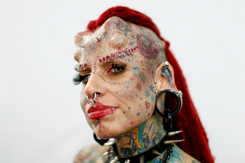 ". Mexican tattoo star Mary Jose Cristerna, better known as ""La Mujer Vampiro\"" (Female Vampire), poses during a tattoo exhibition in Caracas January 27, 2012. REUTERS/Jorge Silva"