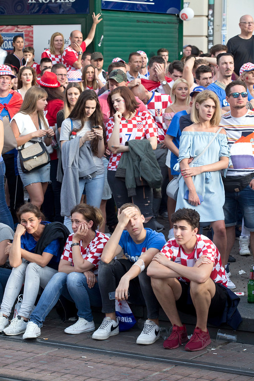 . Supporters of the Croatian national soccer team look dejected in central Zagreb,  Croatia, Sunday, July 15, 2018. Croatia\'s national soccer team lost to France in the World Cup final in Russia. (AP Photo/Marko Drobnjakovic)