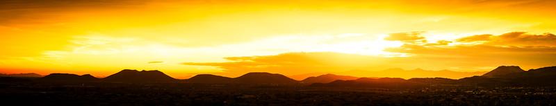 Golden Sunset Panorama over a Desert Landscape