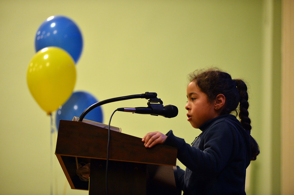 . Sankofa Academy second-grader Graciela Giraldo steps to the microphone as she participates in the school\'s second annual spelling bee in Oakland, Calif. on Wednesday, Jan. 23, 2013. Graciela would go on to be the top finishing second-grader. (Kristopher Skinner/Staff)