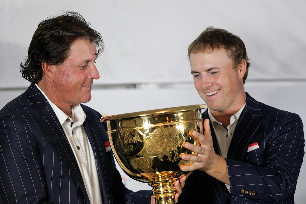 . United States team player Jordan Spieth, right, and teammate Phil Mickelson hold the Presidents Cup after the U.S. won the Presidents Cup golf tournament at Muirfield Village Golf Club Sunday, Oct. 6, 2013, in Dublin, Ohio. (AP Photo/Jay LaPrete)