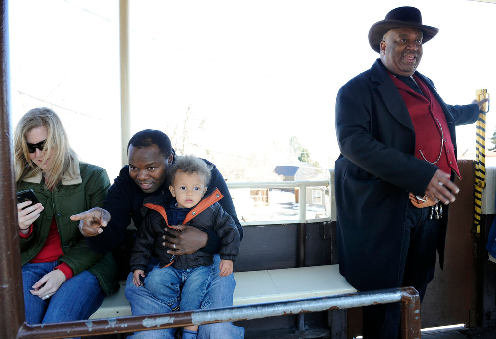 Description of . James Keown, right, plays the part of sheriff Willy Kennard as the Colorado Railroad Museum in Golden hosts a Black History Month event, Black on Track: African American Connections and Stories. Members of the James P. Beckworth Mountain Club, historical reenactors from Denver, gave visitors an experience of the African American connections and stories that contributed to both the railroad and cultural history of Colorado. Kathryn Scott Osler, The Denver Post
