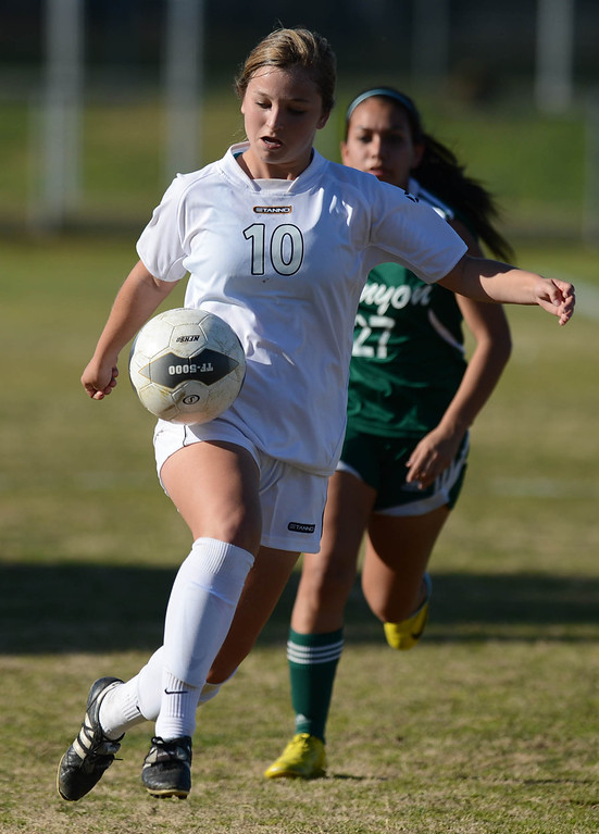. Peninsula\'s Victoria Buda (10) races the ball down field ahead of Canyon\'s Alissa Munguia (27) in a CIF SS Division II first round soccer game Thursday in Rolling Hills Estates. After Peninsula seemingly dominated most of the game, Canyon scored a goal in the final two minutes to win 1-0. 20130214 Photo by Steve McCrank / Staff Photographer