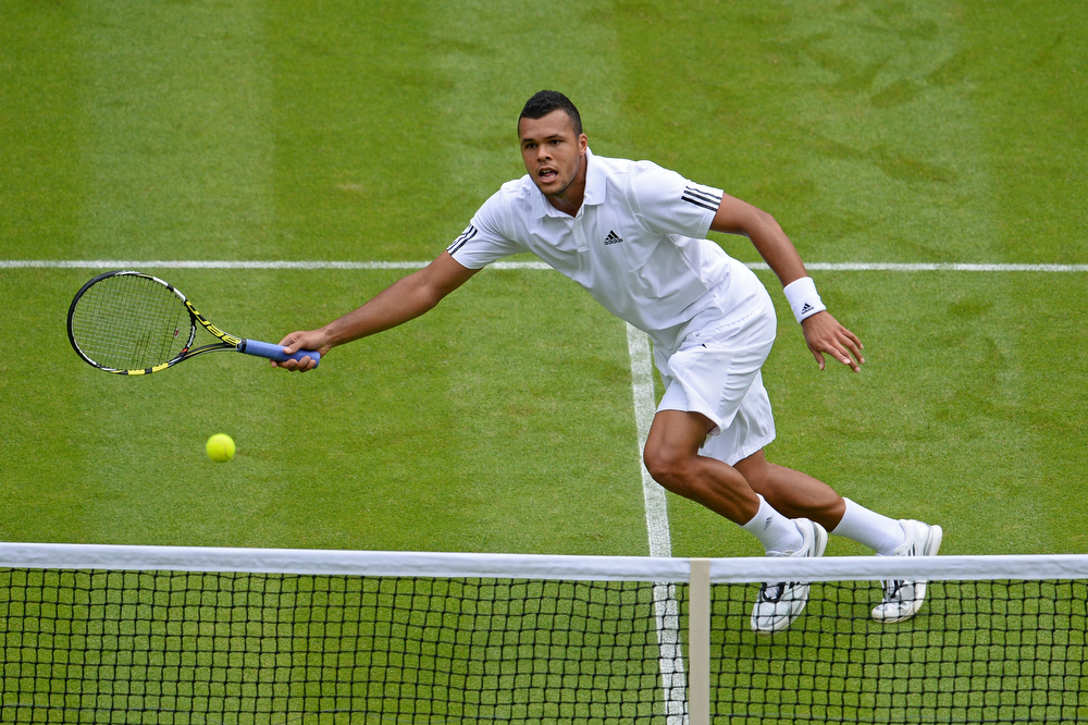 . Jo-Wilfried Tsonga of France plays a forehand during his Gentlemen\'s Singles second round match against Ernests Gulbis of Latvia on day three of the Wimbledon Lawn Tennis Championships at the All England Lawn Tennis and Croquet Club on June 26, 2013 in London, England.  (Photo by Mike Hewitt/Getty Images)