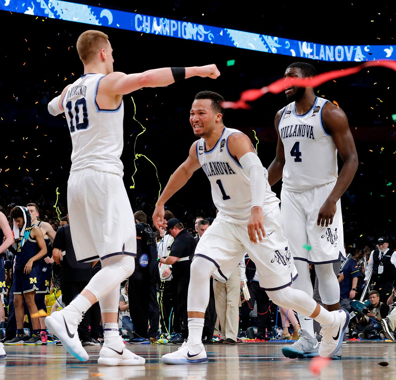 . Villanova\'s Donte DiVincenzo (10) and Jalen Brunson (1) celerbate after the championship game of the Final Four NCAA college basketball tournament against Michigan, Monday, April 2, 2018, in San Antonio. Villanova won 79-62. (AP Photo/David J. Phillip)