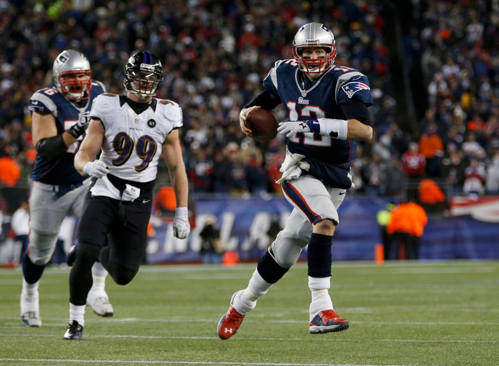 Description of . New England Patriots quarterback Tom Brady (12) is chased by Baltimore Ravens outside linebacker Paul Kruger (99) as he runs in the first half of the NFL AFC Championship football game in Foxborough, Massachusetts, January 20, 2013. REUTERS/Mike Segar