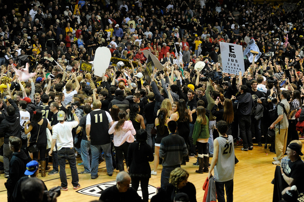 . BOULDER, CO. - FEBRUARY 14: Buffs fans rushed the court at the conclusion. The University of Colorado men\'s basketball team defeated Arizona 71-58 Thursday night, February 14, 2013 at the Coors Event Center in Boulder. (Photo By Karl Gehring/The Denver Post)