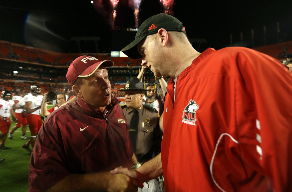 Description of . (L-R) Head coach Jimbo Fisher of the Florida State Seminoles is congratulated by head coach Rod Carey of the Northern Illinois Huskies after FLorida State won 31-10 during the Discover Orange Bowl at Sun Life Stadium on January 1, 2013 in Miami Gardens, Florida.  (Photo by Streeter Lecka/Getty Images)