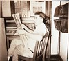 Radio station employee reading paper August 1952