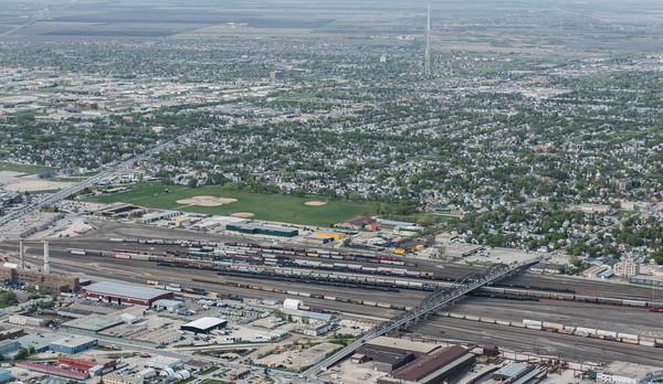 DAVID LIPNOWSKI / WINNIPEG FREE PRESS  Arlington Bridge dividing North/South Winnipeg  Aerial photography over Winnipeg May 18, 2016 shot from STARS helicopter.