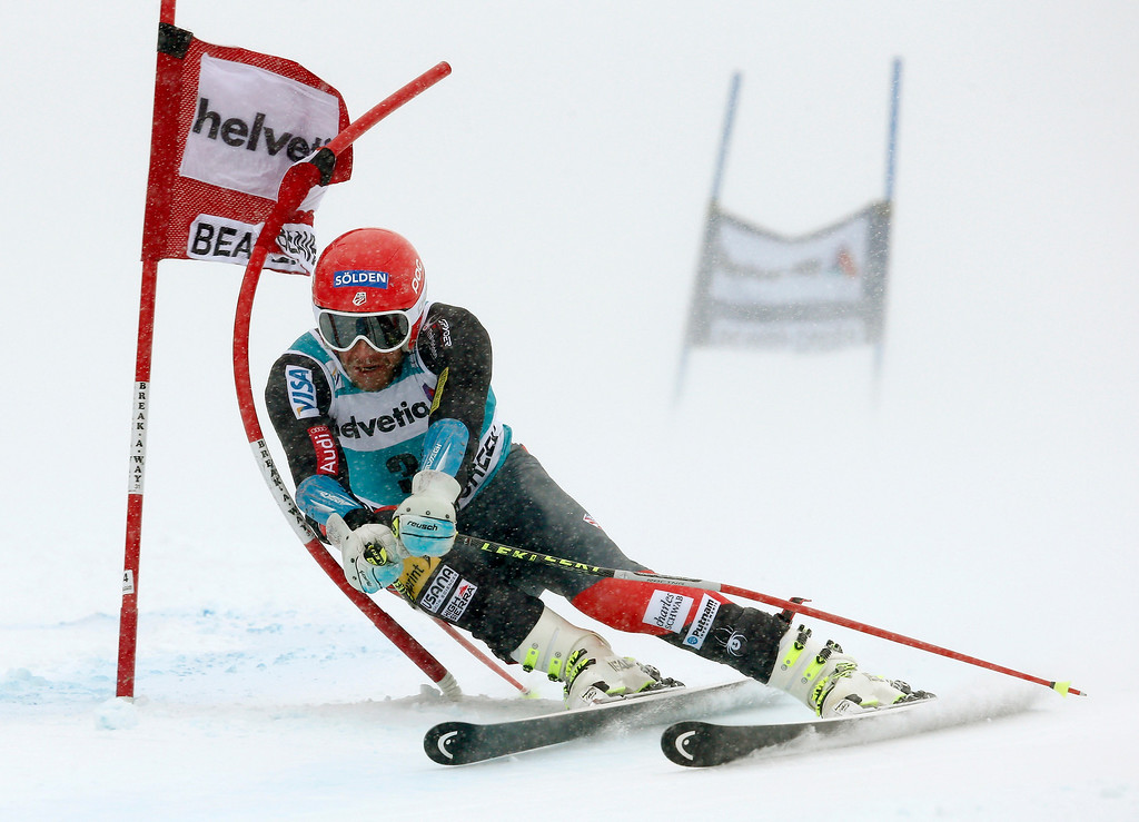. Bode Miller clips a gate on his first run during the men\'s World Cup giant slalom skiing event, Sunday, Dec. 8, 2013, in Beaver Creek, Colo.(AP Photo/ Charles Krupa)
