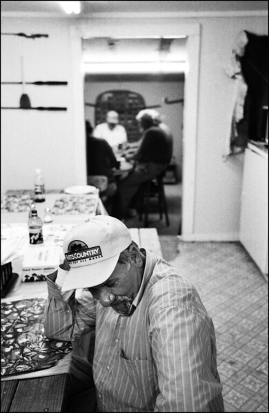 A man waits for a friend who is playing cards