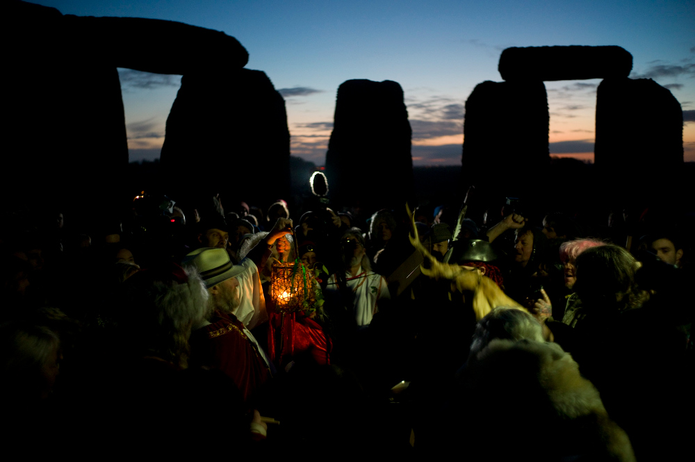 Description of . Revellers chant incantations during the winter solstice at Stonehenge on Salisbury Plain in southern England December 21, 2012. The winter solstice is the shortest day of the year, and the longest night of the year. REUTERS/Kieran Doherty