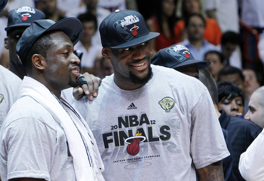. Miami Heat\'s Dwyane Wade, left, and LeBron James stand together during the trophy presentation following the Heat\'s 101-88 victory over the Boston Celtics in Game 7 in the NBA basketball Eastern Conference Finals playoff series, Saturday, June 9, 2012, in Miami. (AP Photo/Lynne Sladky)