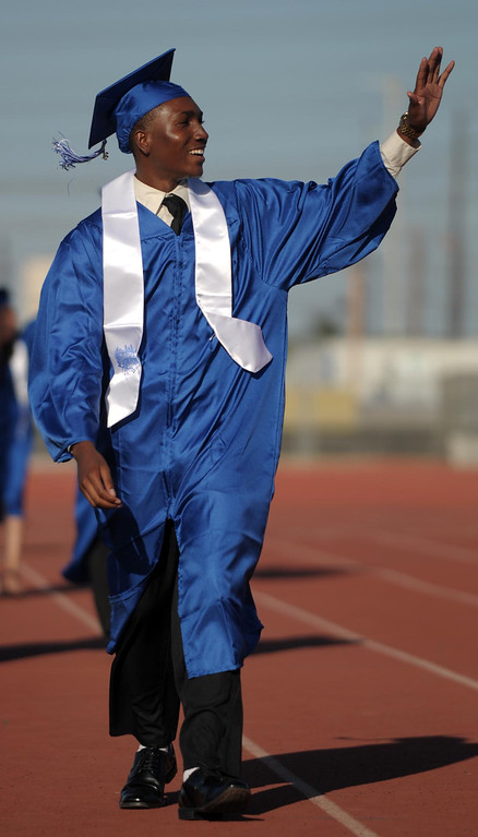 . DeMante Allen Jackson waves to family. The 2013 North High School commencement ceremonies take place on the school\'s football field in Torrance Wednesday afternoon.