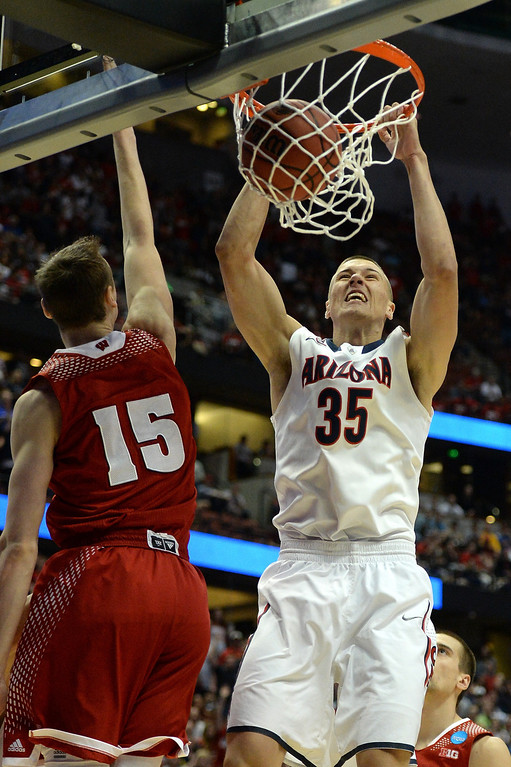 . Kaleb Tarczewski #35 of the Arizona Wildcats dunks the ball over Sam Dekker #15 of the Wisconsin Badgers in the first half during the West Regional Final of the 2014 NCAA Men\'s Basketball Tournament at the Honda Center on March 29, 2014 in Anaheim, California.  (Photo by Harry How/Getty Images)