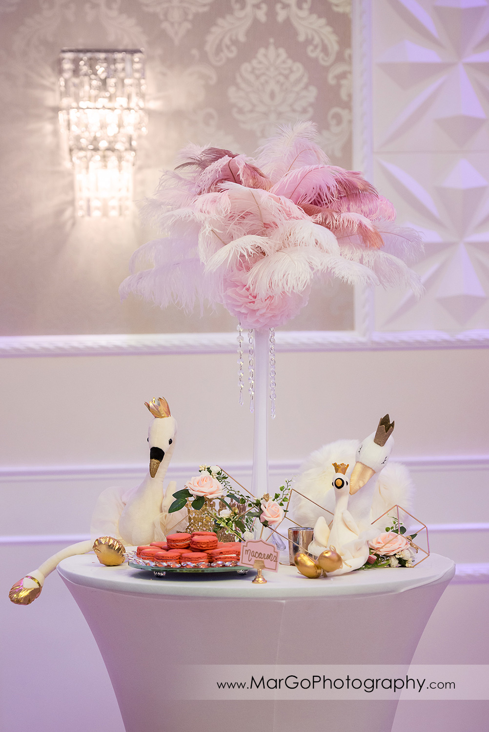 white swans and pink feathers table decor at Newark Oasis Palace
