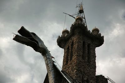 The dragon and the highest (left) tower, in the background.