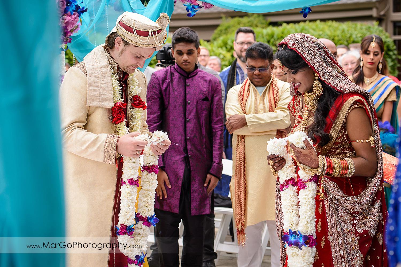 indian bride and groom during jaymala at Brazilian Room - Tilden Regional Park, Berkeley