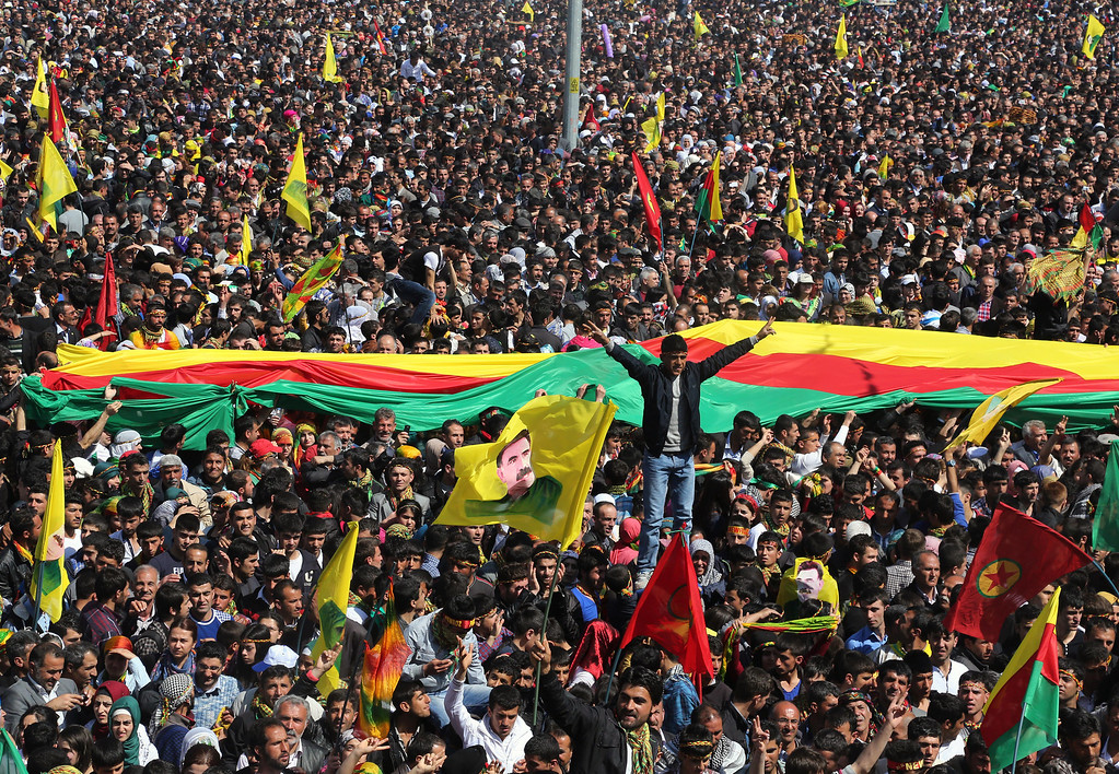 . Some thousands of supporters demonstrate waving various PKK flags and posters of jailed Kurdish rebel leader Abdullah Ocalan, in southeastern Turkish city of Diyarbakir, Turkey, Thursday, March 21, 2013, as Ocalan called Thursday for an immediate cease-fire and for thousands of his fighters to withdraw from Turkish territory, a major step toward ending the fighting for self-rule for Kurds in southeastern Turkey, one of the world\'s bloodiest insurgencies lasting nearly 30-years and costing tens of thousands of lives. (AP Photo)