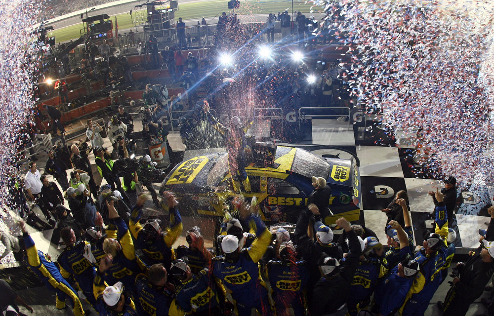 Description of . Matt Kenseth celebrates after winning the NASCAR Daytona 500 Sprint Cup series auto race at Daytona International Speedway in Daytona Beach, Fla., Monday, Feb. 27, 2012. (AP Photo/Matthew Stockman)