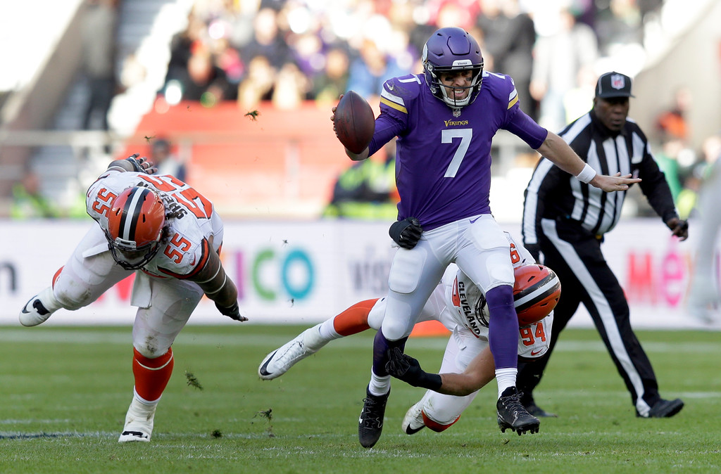 . Minnesota Vikings quarterback Case Keenum (7) scrambles away from Cleveland Browns nose tackle Danny Shelton during first quarter of an NFL football game at Twickenham Stadium in London, Sunday Oct. 29, 2017. (AP Photo/Tim Ireland)