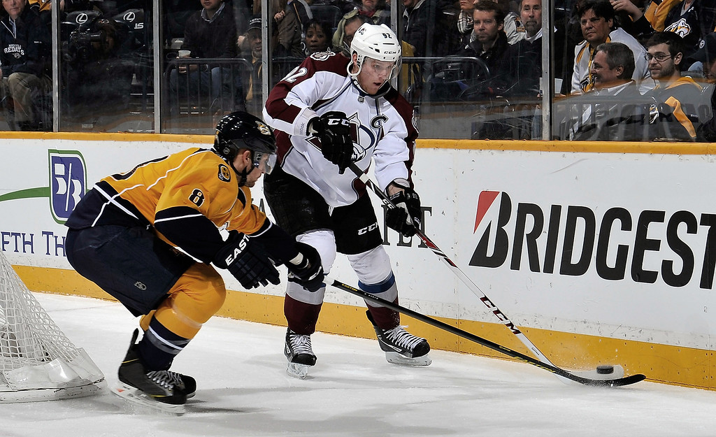 . Chuck Kobasew #12 of the Colorado Avalanche skates against Kevin Klein #8 of the Nashville Predators at the Bridgestone Arena on April 2, 2013 in Nashville, Tennessee.  (Photo by Frederick Breedon/Getty Images)
