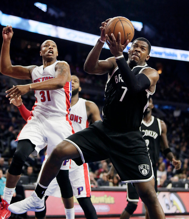 . Brookyn Nets\' Joe Johnson (7) grabs a rebound in front of Detroit Pistons\' Caron Butler (31) during the second half of an NBA basketball game Saturday, Nov. 1, 2014, in Auburn Hills, Mich. Johnson scored 34 points and pulled down eight rebounds in a 102-90 win over the Pistons. (AP Photo/Duane Burleson)