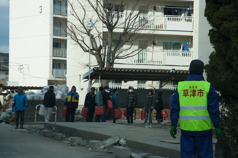 People queuing for heating oil. While the day s are getting warmer in April night are very cold.